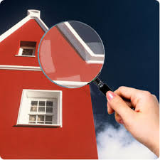 Picture of a home with a magnifying glass to it